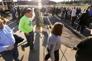 The congregation gathers around the blacksmith during The Beating Guns Tour at Toledo Mennonite Church in Toledo, Ohio on Monday April 15, 2019. The Beating Guns Tour is a 35 city tour to turn guns into garden tools to raise awareness of the mass number of gun violence related deaths in the US. THE BLADE/REBECCA BENSON CTY GUNS16