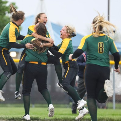 Clay's Tiffany Stevens (14), center, jumps on Brianna Pawlaczyk (21) after winning the Division I district softball final against Springfield at Rolf Park softball complex in Maumee, Ohio on Friday May 17, 2019. Clay defeated Springfield 3-1. THE BLADE/REBECCA BENSON SPT D1soft18p