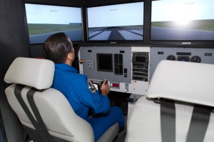 Acaba, whose parents hail from Puerto Rico, takes the Polytechnic University's simulator for a spin Thursday.