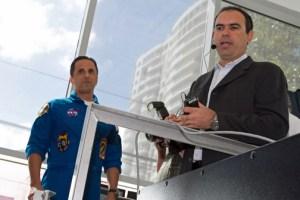Astronaut Joe Acaba, left, looks on as Prof. Rafael Jiménez-Vélez, mechanical engineering professor, explains the flight simulator's featured.