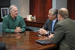 (From left) Pattern Energy CEO Mike Garland meets with Economic Development and Commerce Secretary Alberto Bacó, as Hunter Armistead, Pattern Energy's executive director listens.