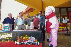 Famous Dave's executives Steve Pierce, Jorge Colón-Gerena, Abelardo Ruiz, Paat Naughton, Alex Lignos during Wednesday's meet-and-greet. Wilbur, the chain's mascot, looks on.