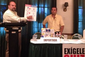 Puerto Rico Farm Bureau President Ramón González (at podium) shows the price difference resulting from buying products based on imported milk.