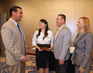 From left: Joey Cancel, second vice of the government guaranteed loans unit; Carmen Ríos and  Carlos Rivera, Dulzura Borincana owners, and Elsie Nieves, official of FirstBank's government guaranteed loans unit, after the ceremony.
