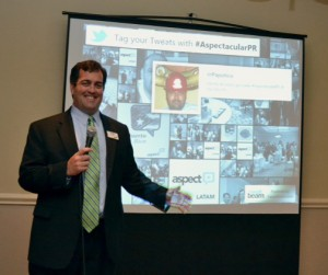 Bryan Sheppeck, senior vice president of Aspect Social, speaks to a group of local customers during a recent visit.