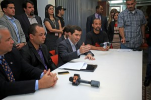 "From left, seated: Economic Development and Commerce Secretary Alberto Bacó and Senators Ramón Luis Nieves and José Nadal-Power discuss the details of the bill filed in favor of ""creative industries."""