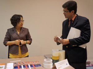 PRTEC Executive Director Francisco Chévere (right) inspects samples brought by a member of the Taiwan business delegation.