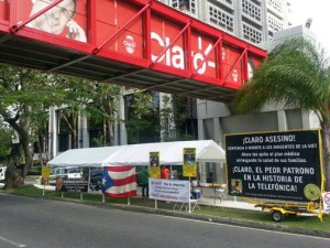 The UIET set up camp in front of Claro's Guaynabo headquarters as drawn-out collective bargaining agreement continue. (https://www.facebook.com/claro.antiobrero)