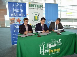 From left: Cape Air executive Stephen Phillips Manuel Fernós and Warren Christie sign the MOU.