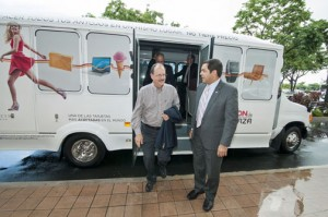 """From left: Plaza Las Américas President Jaime Fonalledas and Miguel Torres, secretary of the Department of Transportation and Public Works were on hand Monday to experience the """"A ride to Plaza"""" service first-hand."""
