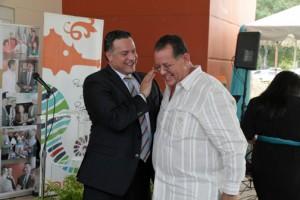 COSSEC President Daniel Rodríguez Collazo and Dorado Mayor Carlos López during the credit union's opening.