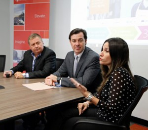 From left: Hernán Rincón, president of Microsoft's Latin American region and Marco Casarín, general manager of Microsoft Puerto Rico and the U.S. Virgin Islands listen as Heidi Cortés, vice president of finance and administration of the United Way of Puerto Rico discusses the benefits of Office 365.