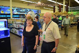 """Ponce Mayor María """"Mayita"""" Meléndez and , Héctor Rodríguez, Petco's market manager, stroll through the new store."""
