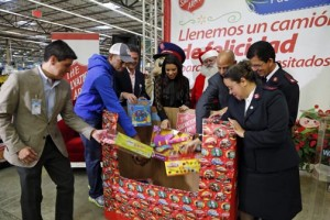 Representatives from Walmart and the Salvation Army kick off the toy drive Thursday.