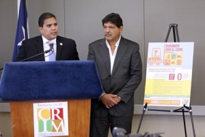 CRIM Executive Director Víctor Falcón-Dávila (at podium) and CRIM Chairman Eduard Rivera Correa.