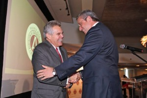 From left: AGC incoming President Raul J. Brás Cummings shakes hands with Gov. García-Padilla Wednesday.