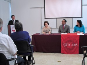 At podium, Sila M. Calderón Foundation President Dennis Román-Roa offers details of the initiative, as former Gov. Calderón, Wendell Pritchett, chancellor of the Rutgers University Camden Campus, and Prof. Gloria Bonilla-Santiago, listen.