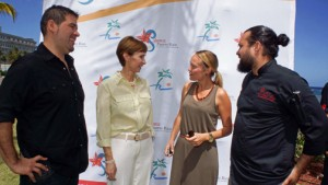 From left: Chef Roberto Treviño and PRHTA President Clarisa Jiménez talk with two of this year's event participants.
