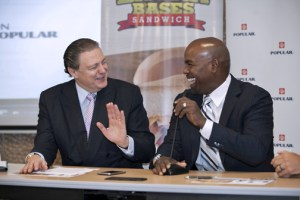 Popular Inc. President Richard Carrión and Extra Bases founder Carlos Delgado are all smiles during the news conference to announce the fundraising campaign.