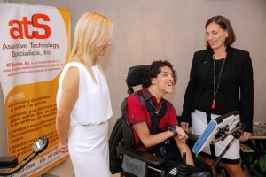 During a demonstration of the Tobii device, at Assistive Technology Specialist facilities, from left are Janet Carrasquillo, president of Assistive Technology Specialists, Inc.; Xavier Rivera Arroyo, patient and Mari Evelyn Rodriguez, senior vice president of FirstBank's Business Banking.