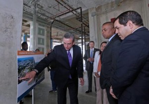 "From left: Gov. García-Padilla, U.S. Transportation Secretary Anthony Foxx and Puerto Rico Transportation Secretary Rubén Torres review the plans for the ""Sciences Boulevard"" project."