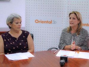 Lola Yglesias, executive director of Enactus Puerto Rico and Alexandra López-Soler, senior vice president of marketing and public relations for Oriental offer details of the new partnership.
