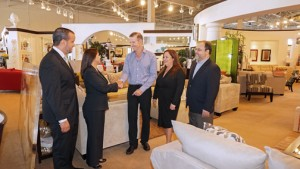 Rooms to Go and Doral executives meet to finalize the details of the newly minted partnership.