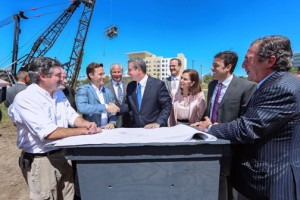 Gov. Alejandro García-Padilla (center) participates in the groundbreaking ceremony, along with hotel executives and government officials.