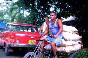 A man transports sacks of sugar on his bicycle in Havana's Miramar district. (Credit: Larry Luxner)