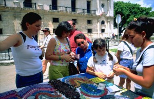 Tourists with euros and convertible pesos browse through necklaces, beads and other trinkets at the hard currency crafts market in Old Havana. By the end of 2014, Cuba's dual-currency system will begin to be dismantled. (Credit: Larry Luxner)