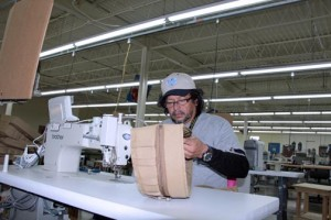 An unidentified employee works on one of the items to be produced at Raine's new Mayagüez operations.