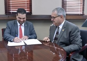 TRB President Javier Rúa-Jovet and Police Superintendent José Caldero sign the agreement Monday.
