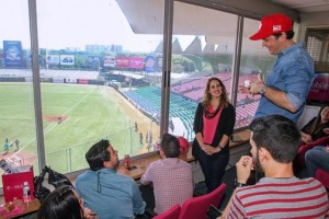 T-Mobile General Manager Jorge Martel (wearing baseball cap) discusses the carrier's new strategies during a news conference at the Hiram Bithorn Stadium in San Juan.