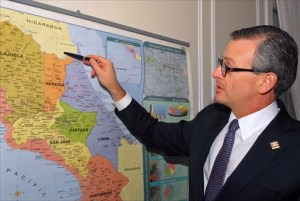 Manuel Antonio González Sanz, foreign minister of Costa Rica, points to his country's disputed border with Nicaragua, which is building a $50 billion transoceanic canal with Chinese financing. (Credit: Larry Luxner)