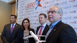 From left: Agustín Arellano, Ingrid Rivera-Rocafort, Holger Blankenstein, commercial director for Volaris, and Economic Development and Commerce Secretary Alberto Bacó, during Tuesday morning's announcement of the new service.