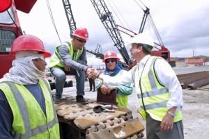 Gov. García-Padilla greets port workers during his visit to Sea Star Line's facilities in San Juan.