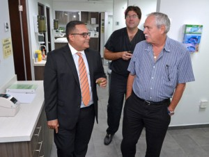(From left) Hari Sabnani and Doctors Jorge Aldrich and Arturo Gigante tour the new lab.