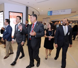 Aerostar CEO Agustín Arellano, center, leads a group during a tour of the renovated terminal at the Luis Muñoz Marín International Airport.