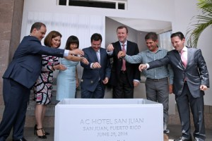 Hotel and government officials conducted the brand's cornerstone ritual that calls for placing a handful of commemorative coins into the foundation plot with the hotel's name and its opening date.