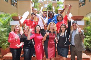 Olympic athletes and representatives from the Puerto Rico Olympic Committee and Walmart Puerto Rico offer details of their fundraising partnership.