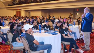 Jim Vella, president, Ford Motor Company Fund and Community Services, addresses a group of high school students at the Condado Plaza Hotel Wednesday.