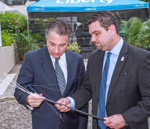 "Liberty Puerto Rico President Naji Khoury and Board President Javier Rúa-Jovet inspect cables during Tuesday's launch of ""ViaDIGITAL"" in Santurce."