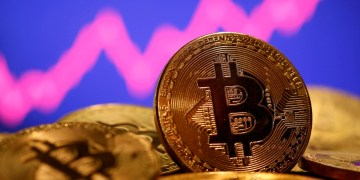 Bitcoin hits $60k record high as cryptocurrency's rally continues