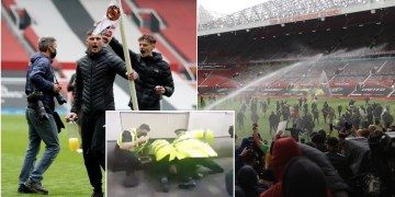 Man United vow to punish 'criminal activity' in wake of Old Trafford unrest as footage shows police officer 'punching protester'