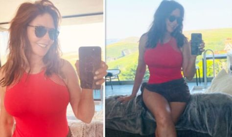 Carol Vorderman (60) causes quite a stir by putting her curves in a red, skin-tight swimsuit