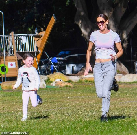 Race: The fitness guru didn't even appear to break a sweat as she darted through the field in her athletic gear