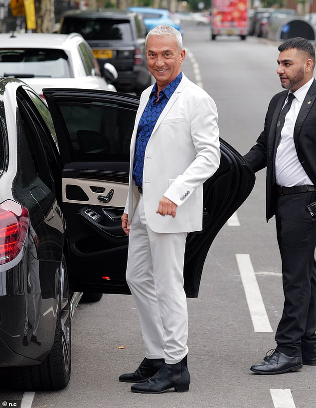 Twinkle toes: Bruno looked dapper in a white suit which complemented his silver hair while wore a blue shirt which he left open at the collar to give his outfit a more casual look