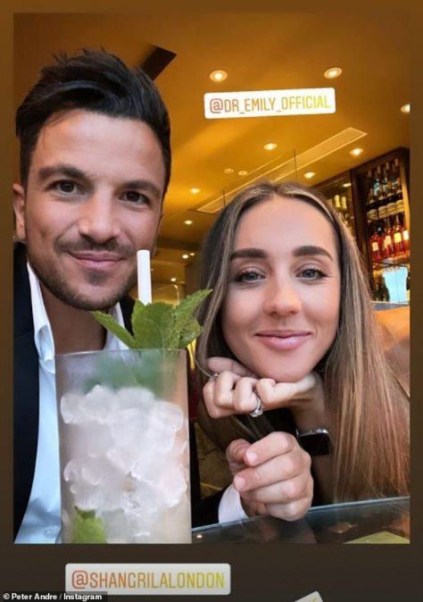 A light tipple: The handsome couple posed together at the upmarket restaurant with a mojito on-hand