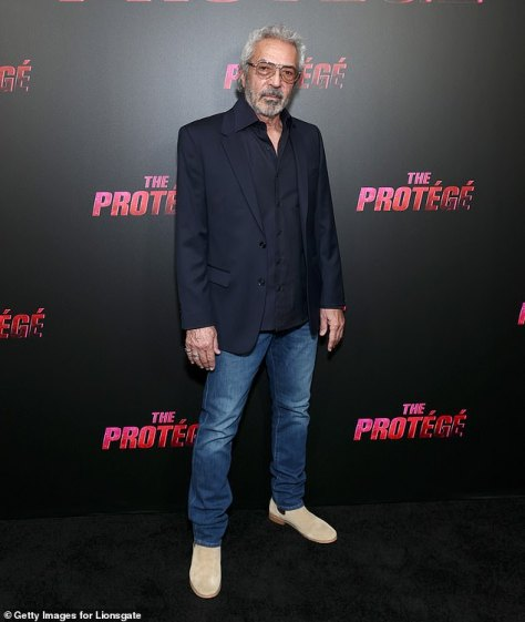 Icon:Acclaimed producer Arthur M. Sarkissian donned a black blazer layered over a black dress shirt and a pair of dark wash denim jeans