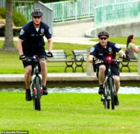 The originals: Both cops wore blue polo shirts and shorts, not unlike their on-screen counterparts, played by Channing Tatum (left) and Jonah Hill (right)
